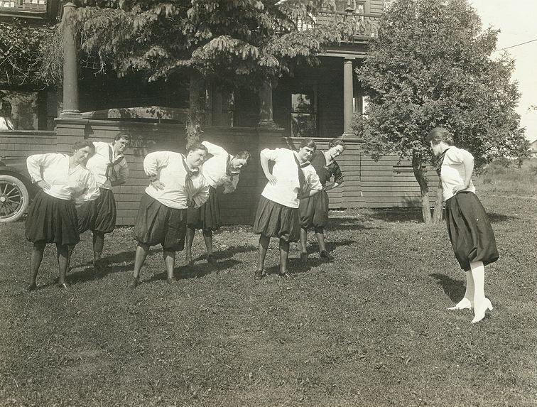 Women exercising in bloomers, c. 1914.