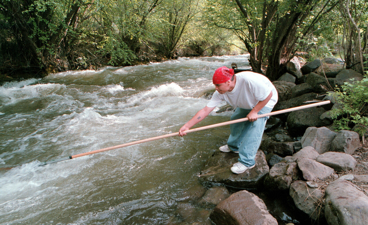 A member of the Nez Perce, Brian J. Pinkham, dipnets for Chinook salmon in Idaho in 2001. For the past several years, the tribe's climate change coordinator, Stefanie Krantz, has been conducting a vulnerability assessment and working on a climate adaptation plan.