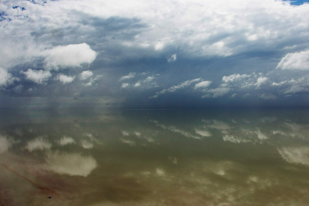 During wet periods, a thin sheen of water coats the salty expanse of the Etosha Pan.