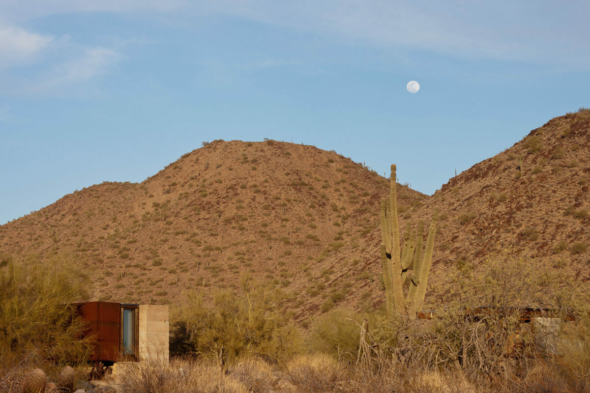 This shelter, Minero, was designed by David Frazee, who was inspired by Arizona's old mining carts. Students like the shelter's design but say its placement is bad: The sun heats it like an oven in the mornings.
