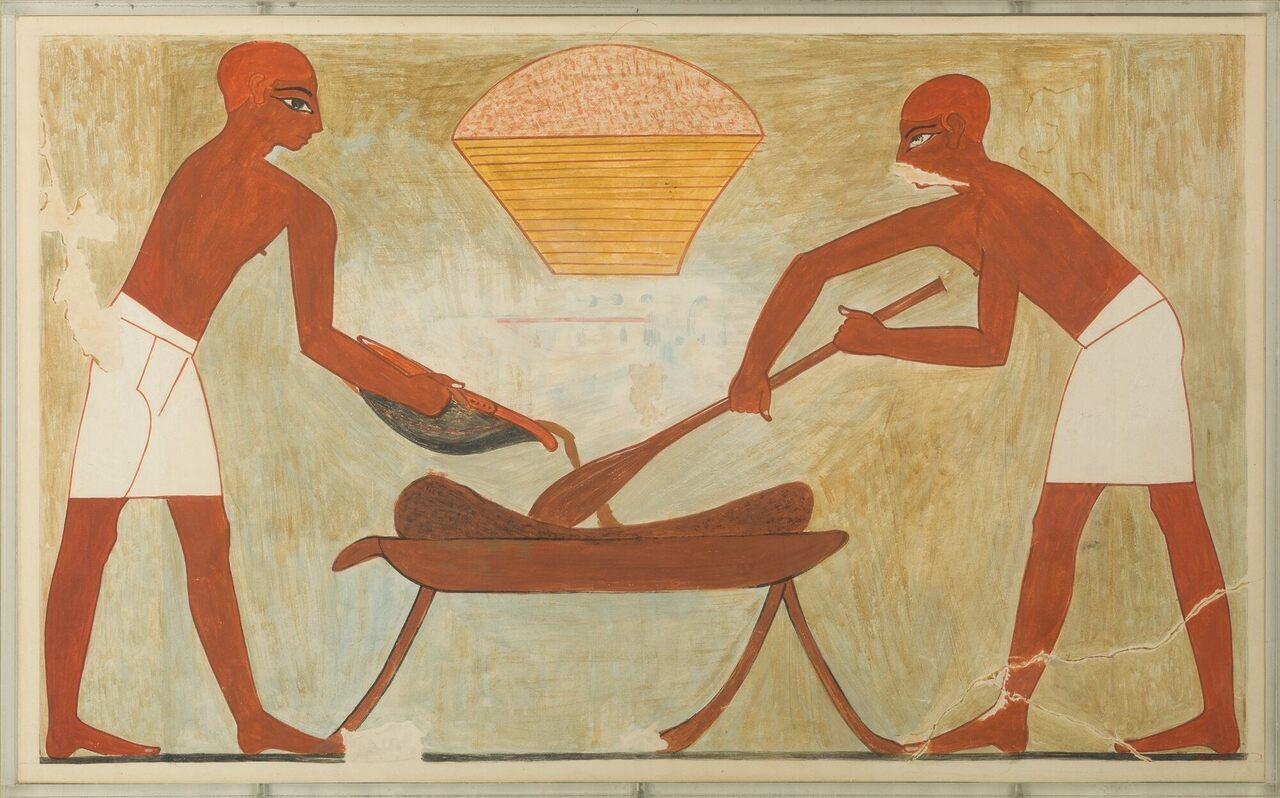 Two workers blend a tiger nut mixture for cakes in this painting from the tomb of a vizier.
