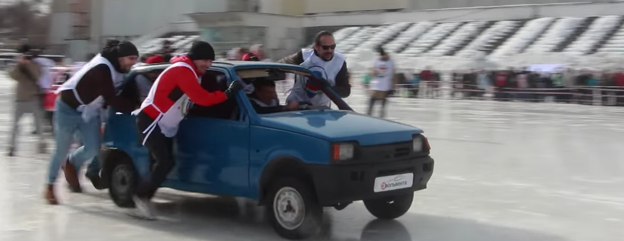 The Russian curlers sending a car down the ice.