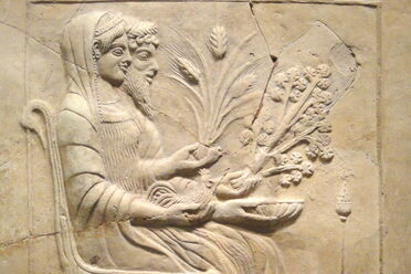 Hades and Persephone, with Persephone holding a branch of parsley (or perhaps celery).