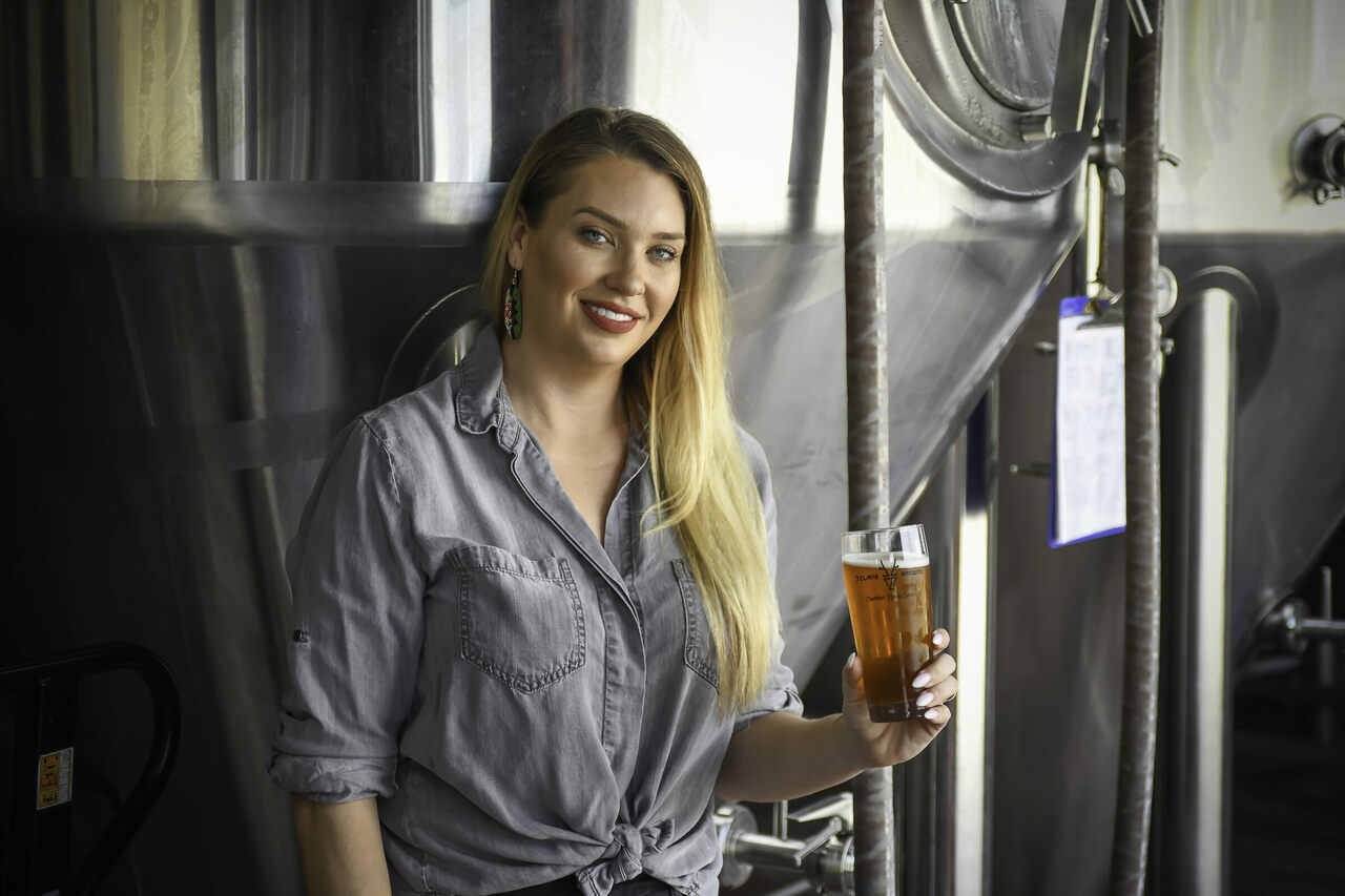 Morgan Crisp holds a beer from 7 Clans, the Native beer brand she cofounded in 2018.