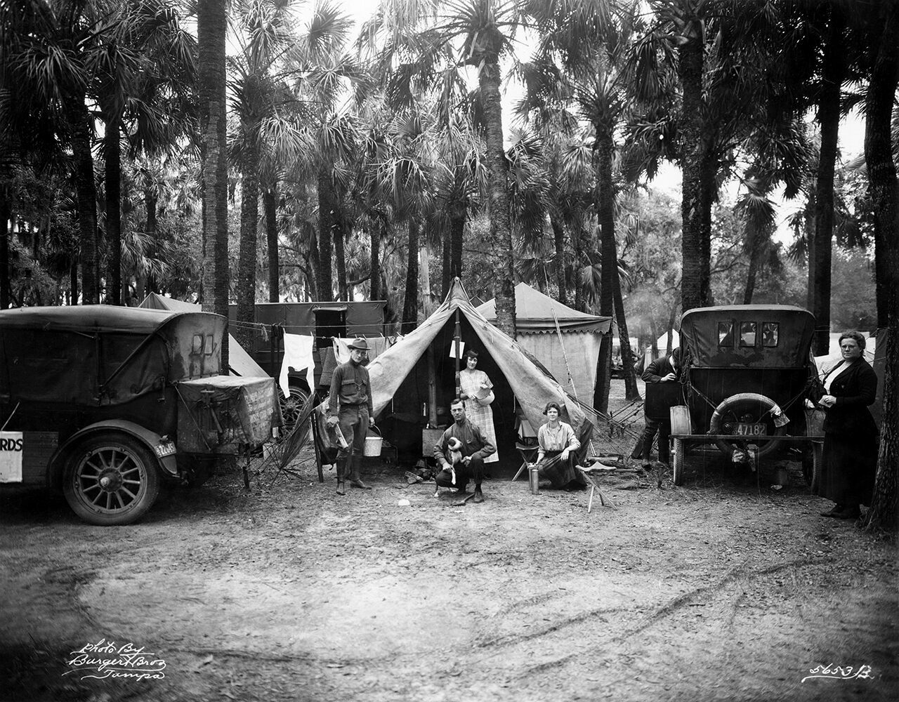 Early RV campers pose for a photo on Christmas Day, 1920, in Desoto Park, Florida—about a year after the first Tin Can Tourists' assembly. The group's ethos—an incongruous mixture of escapism and orderliness—inspired American auto campers to load up their Model Ts and drive along freshly paved roads, searching for scenic spots to camp.