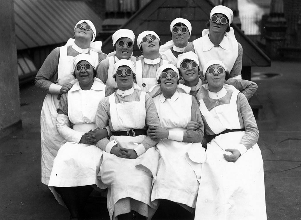 A group of nurses observing a solar eclipse, England, 1927.