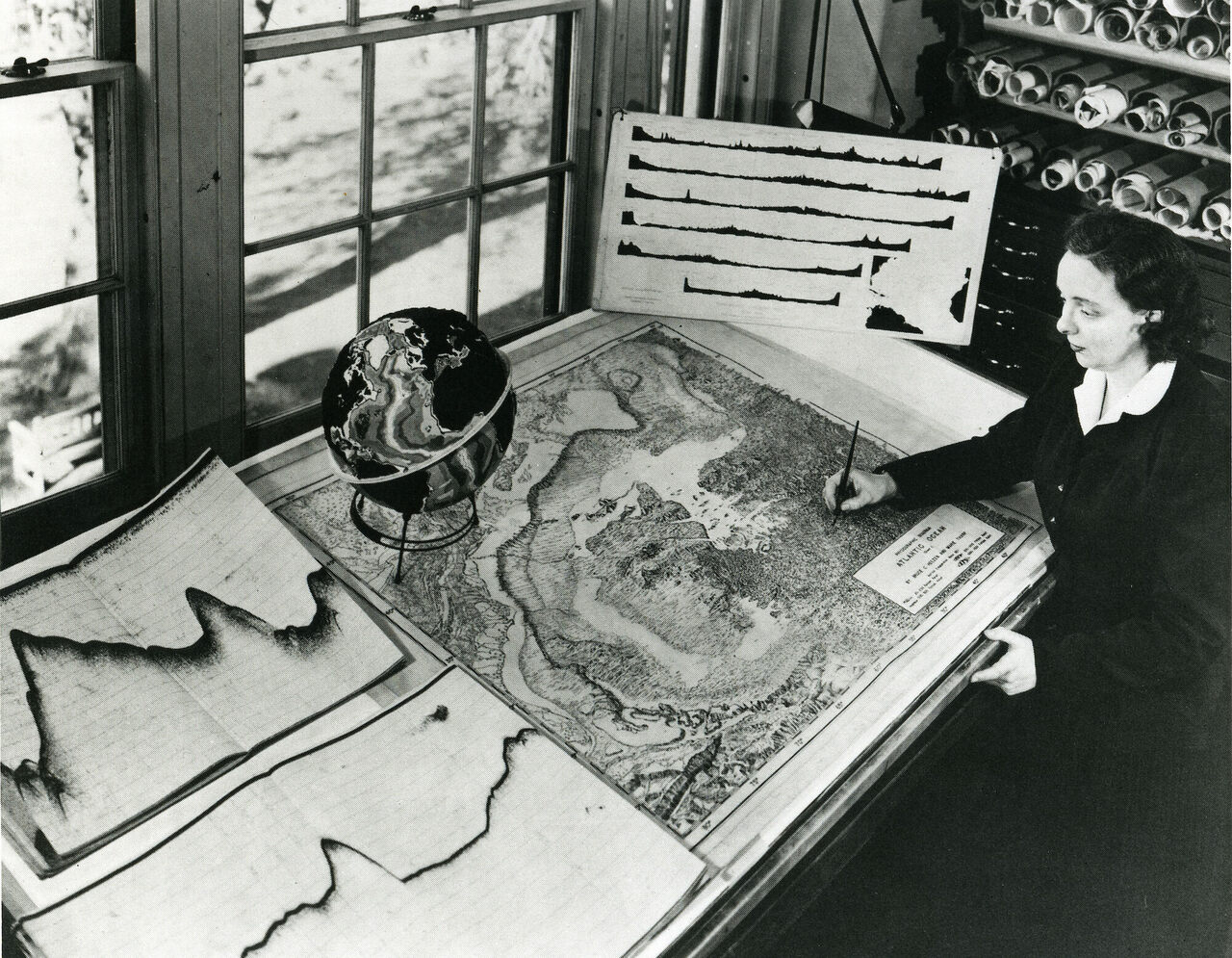 Tharp working on an early map of the seafloor.