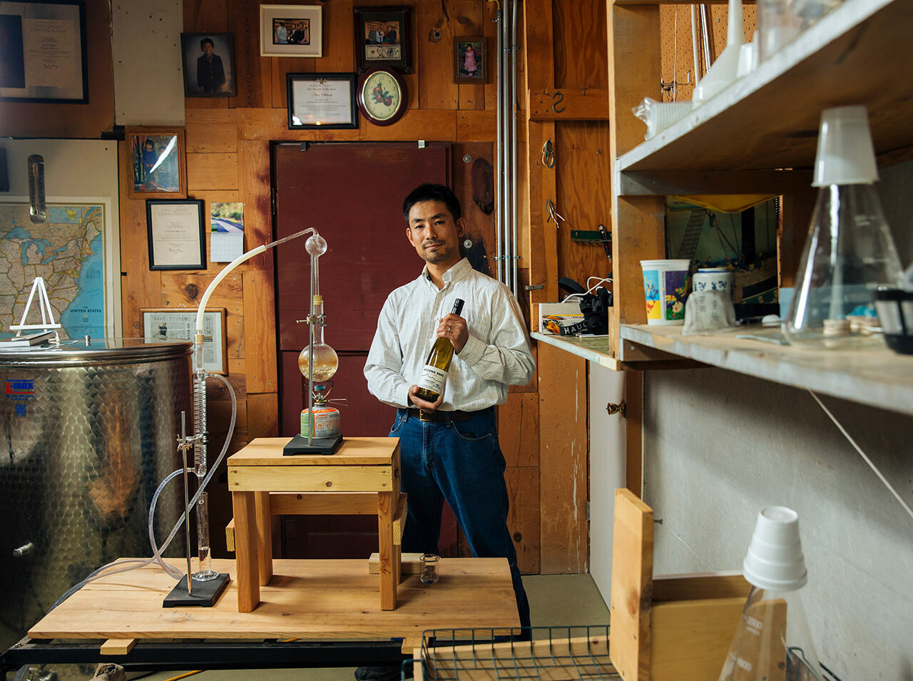 Atsuo Sakurai poses with his Arizona Sake equipment in Holbrook, Arizona.