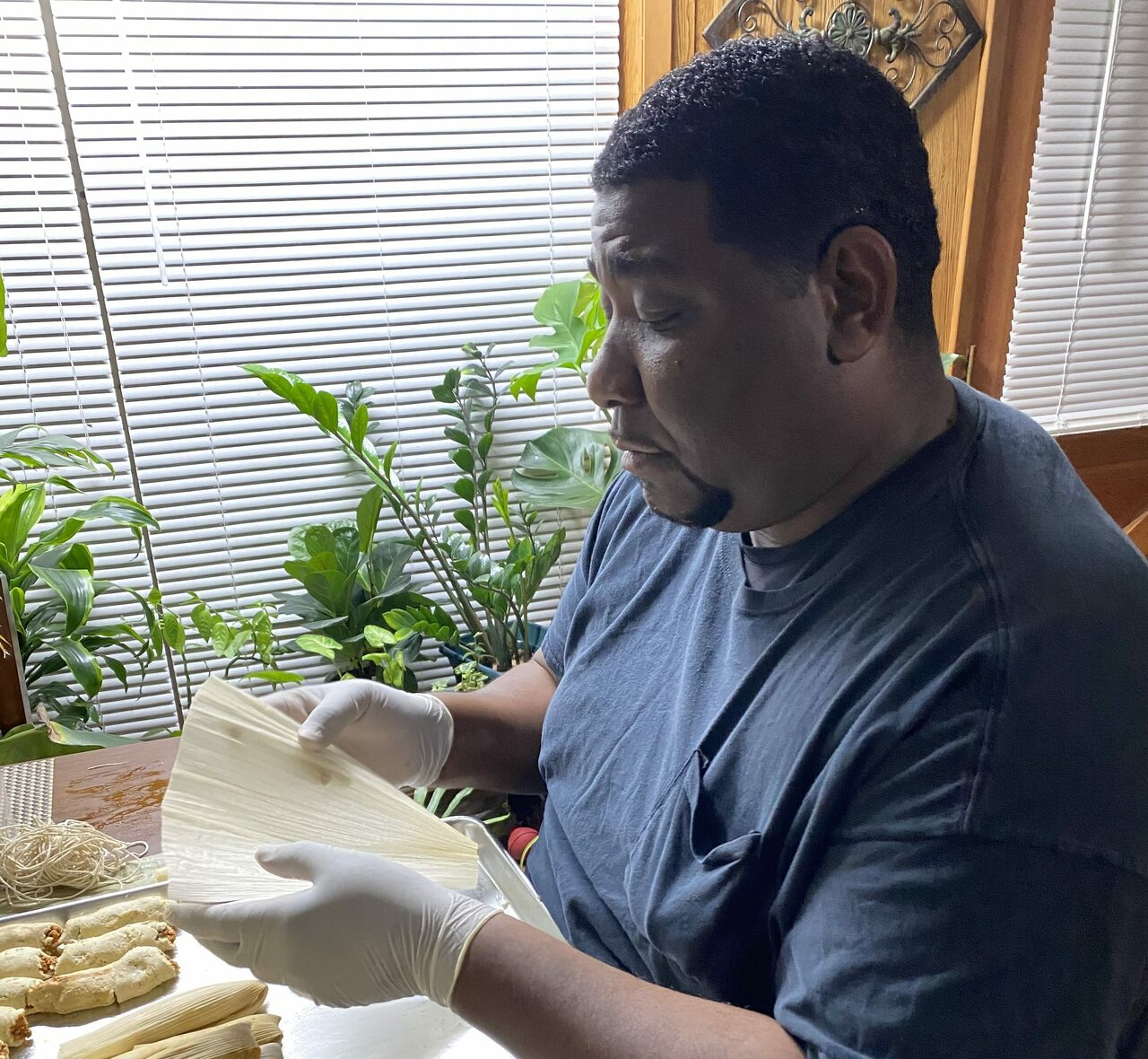 Charles Sledge: a police detective by day, a tamale master the rest of the time.