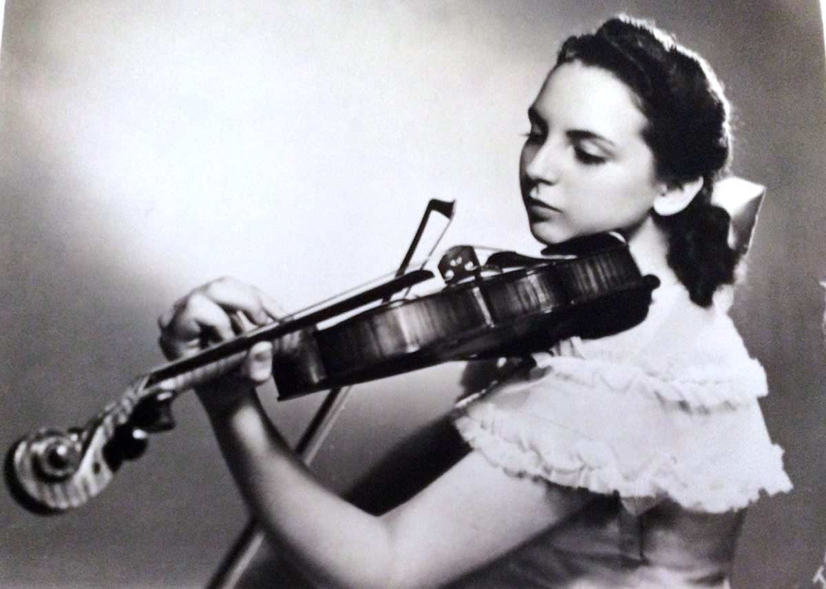 Bernice Stochek Friedson in 1948, aged 16, playing one of her father's violins.