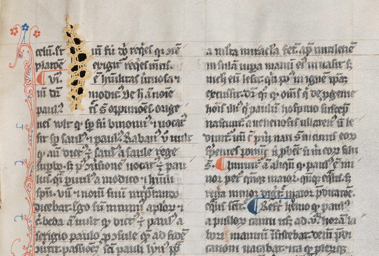Repairs in yellow thread in James of Voragine's 14th-century text <em>Golden Legend</em>.
