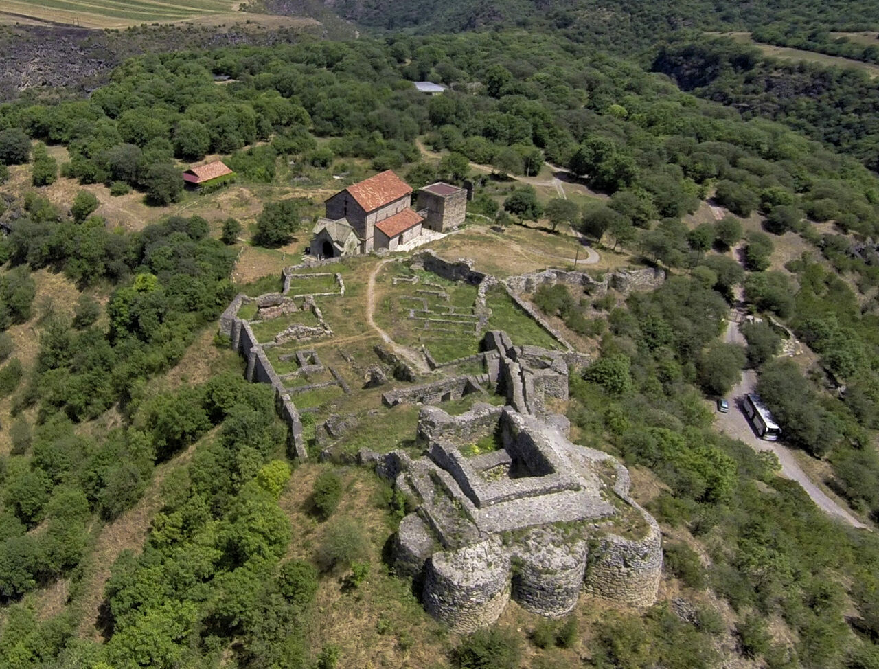 Viewed from overhead, the promontory of Dmanisi includes medieval and Bronze Age ruins, a working monastery, and a small but rich fossil site.