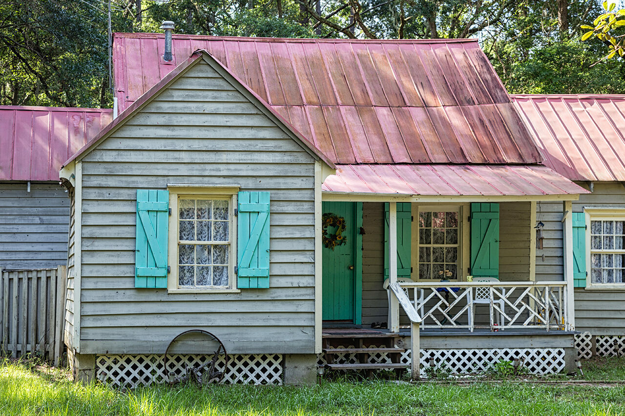 "At this Gullah Geechee home on Daufuskie Island, South Carolina, painted doors and shutters keep out evil spirits called ""haints."""