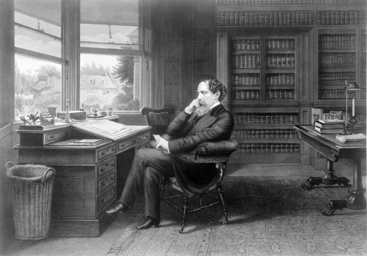 Dickens at work.