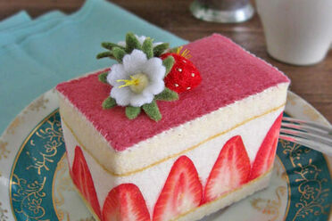 An elegant cake with printed strawberries.