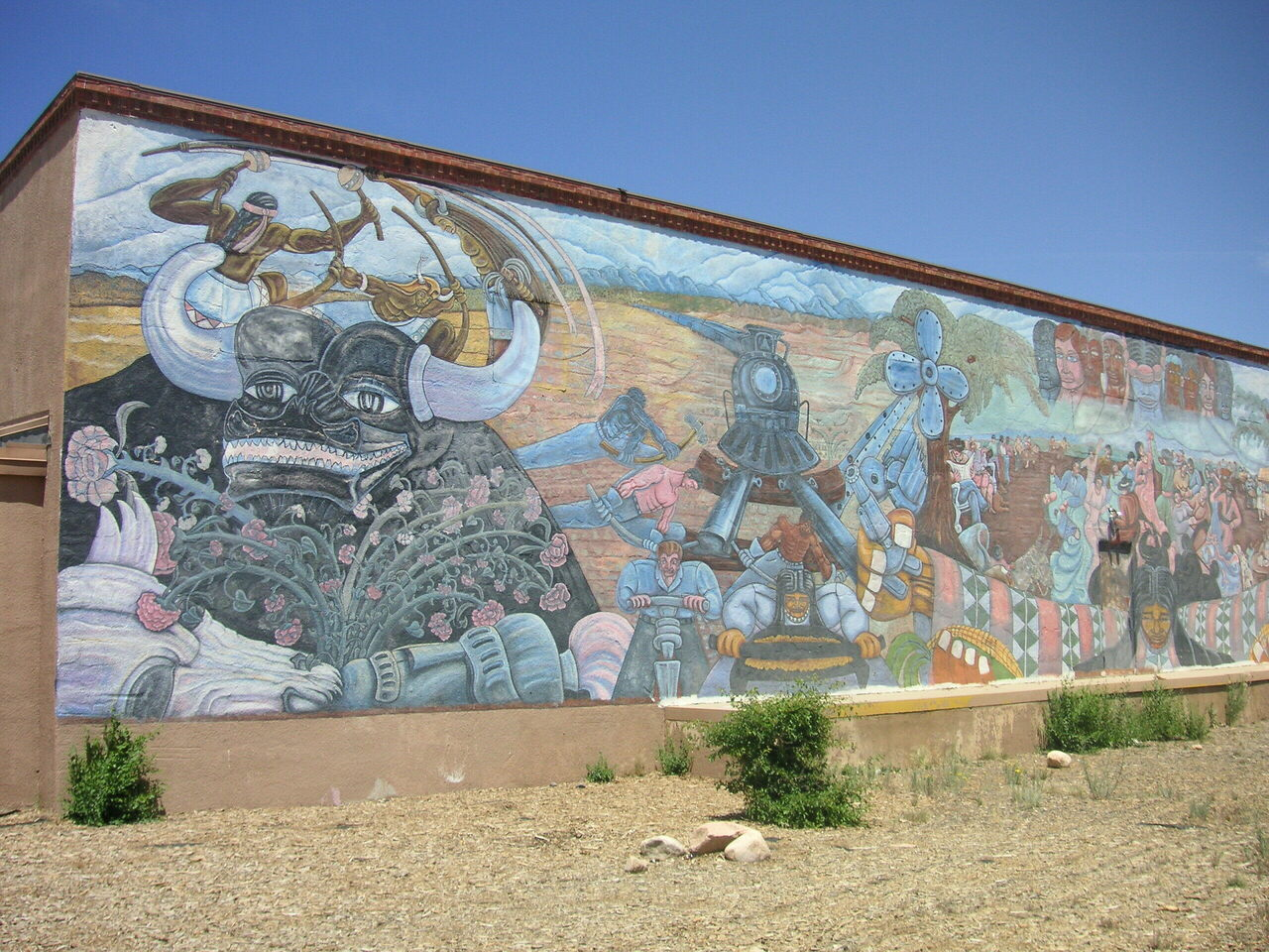 "The left side of ""Multi-Cultural,"" a collaborative mural painted in 1980. State officials approved a plan that would destroy the painting."