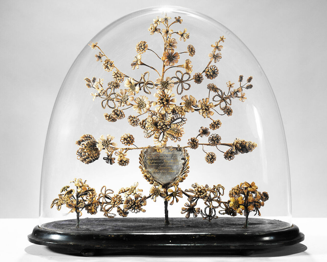 <em>Primitive Methodist Society Dome</em>, made with glass, wood, wire, metal, and human hair using gimp work, 1864.