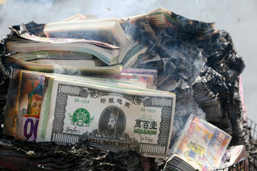 "Burning ""hell money"" so ghosts can spend it in the afterlife is one of China's Hungry Ghost Festival rituals."