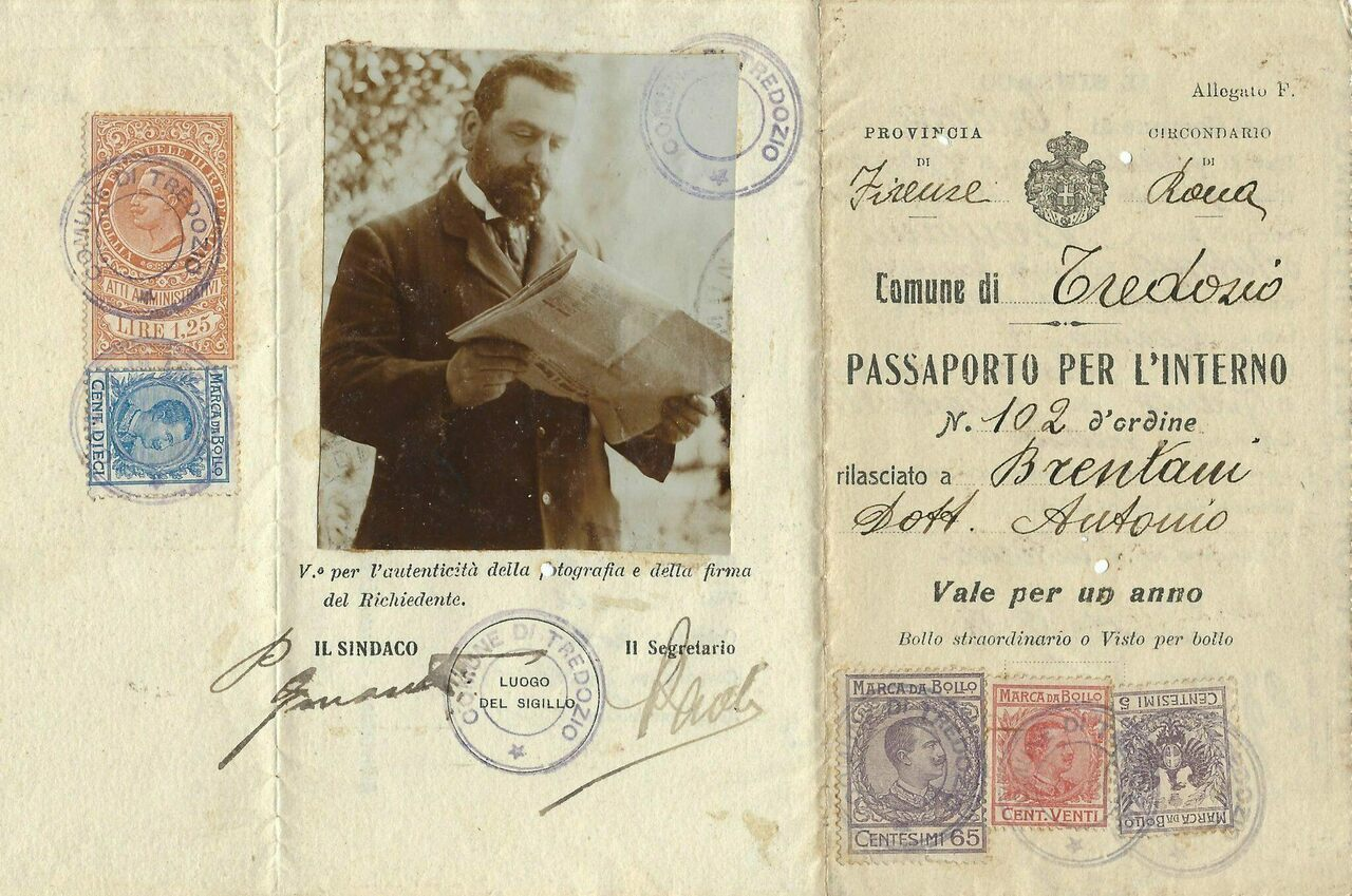 An 1918 Italian passport photo shows its bearer smoking a cigarette and reading a newspaper.
