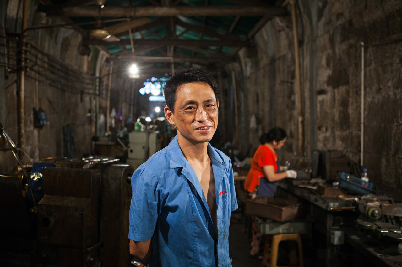 Tan, who works in a machine-parts factory in one of the tunnels under Chongqing.