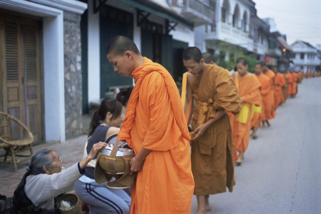 Buddhist monks collecting alms of rice in Luang Prabang, Laos.