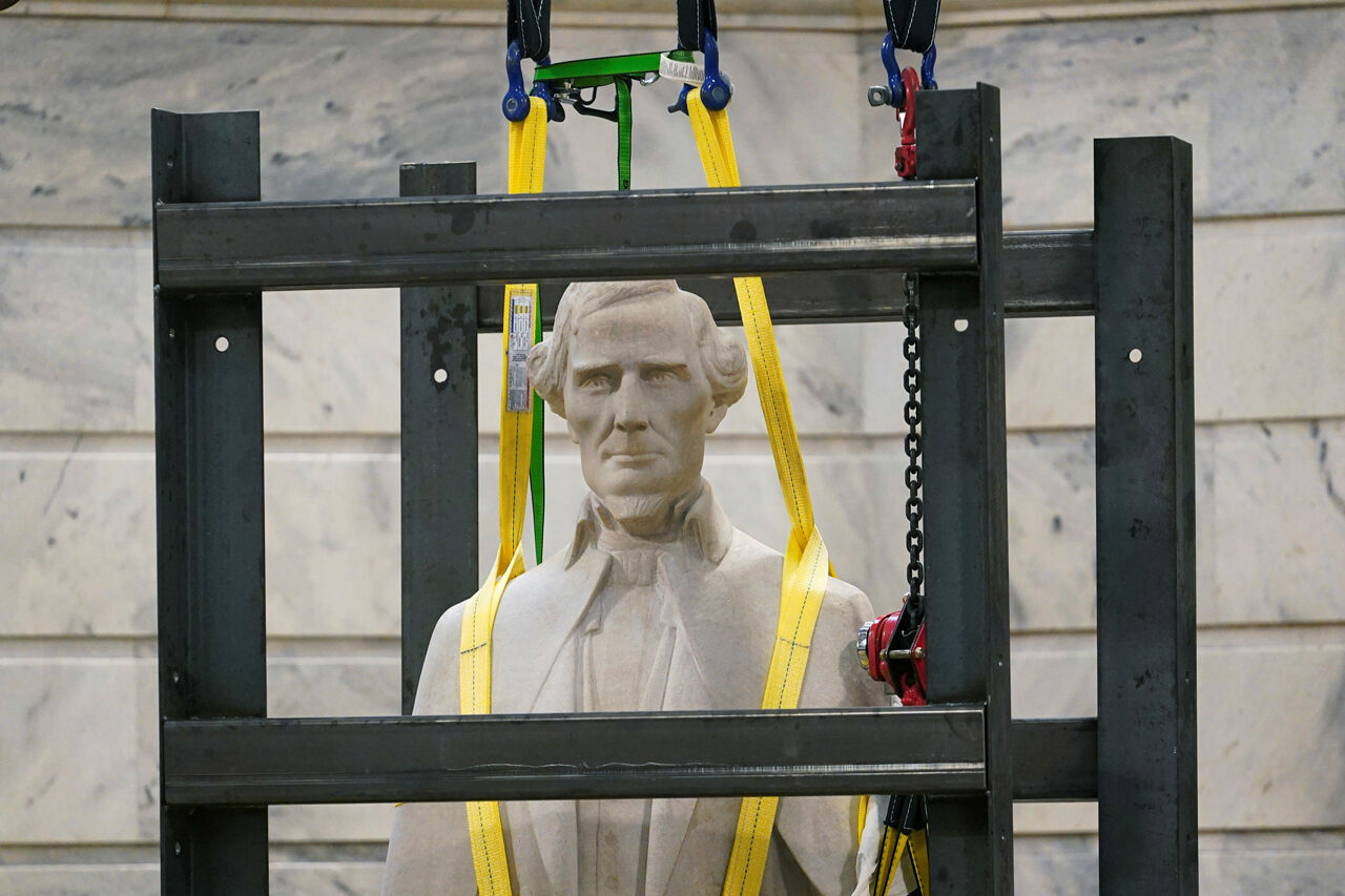 A statue of Confederate President Jefferson Davis is removed from the rotunda of the Capitol Building in Frankfort, Kentucky, on June 13, 2020.