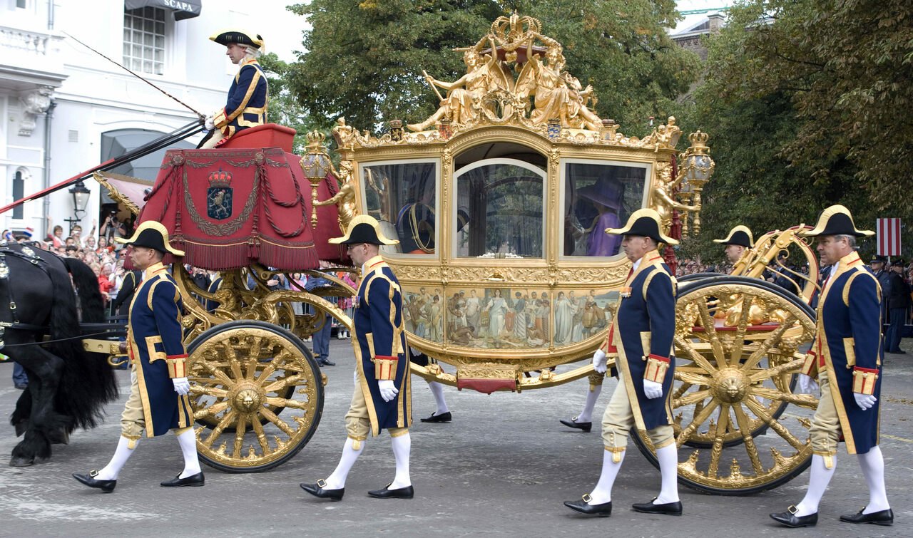 The Golden Coach, pictured here moving through The Hague, has inspired conversations about what to do with artifacts of the colonial era.