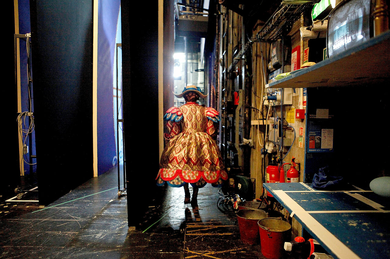 Pantomime Dame Kenneth Alan Taylor walks out onto the stage as Dame Daisy in <em>Jack and the Beanstalk</em> at the Nottingham Playhouse in December 2013.