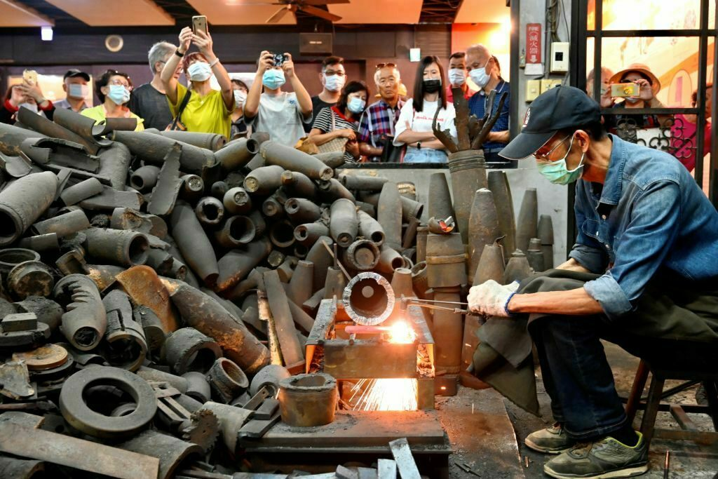 Both Wu Tseng-dong's knives and his forge have become a tourist draw.