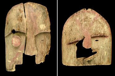 Two wooden Chugach masks.