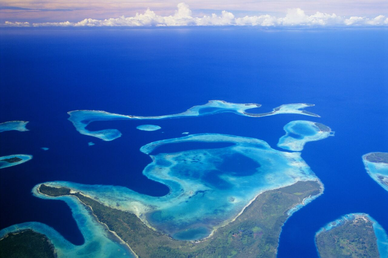 The Solomon Islands include both low-lying atolls and larger landmasses.