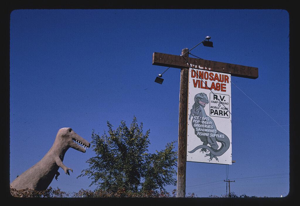 <em>Dinosaur Village RV Mobile Home Park, dinosaur statue and sign, Route 40</em>, Utah, 1991.