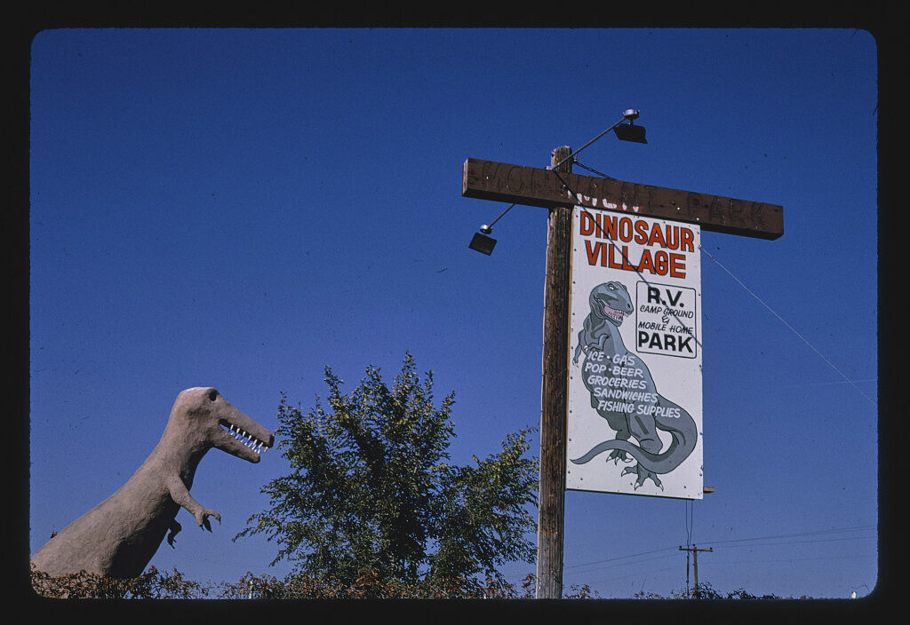 <em>Dinosaur Village RV Mobile Home Park, dinosaur statue and sign, Route 40</em>, Utah, 1991.
