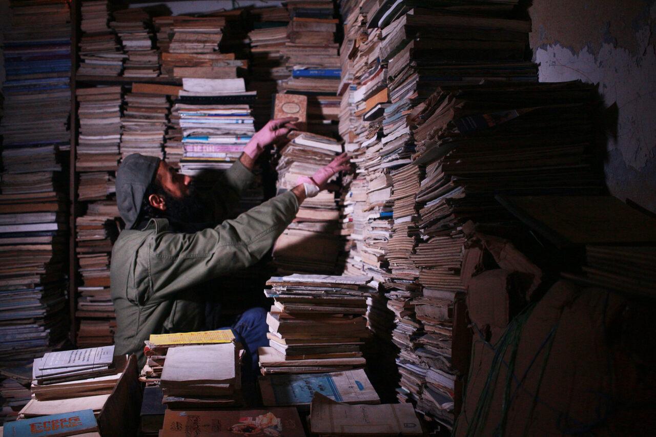 Hamzeh AlMaaytah in his bookstore's storage room.