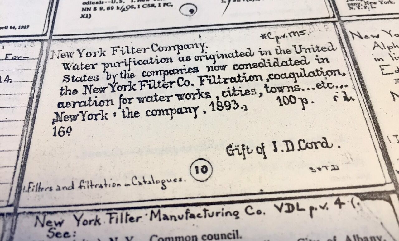 Fancy handwriting on a catalog card from the New York Public Library.