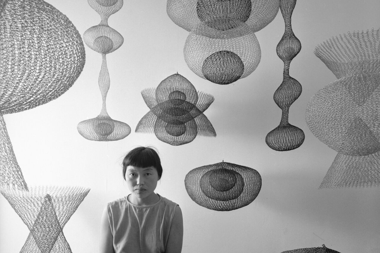 Ruth Asawa and some of her works in 1954.