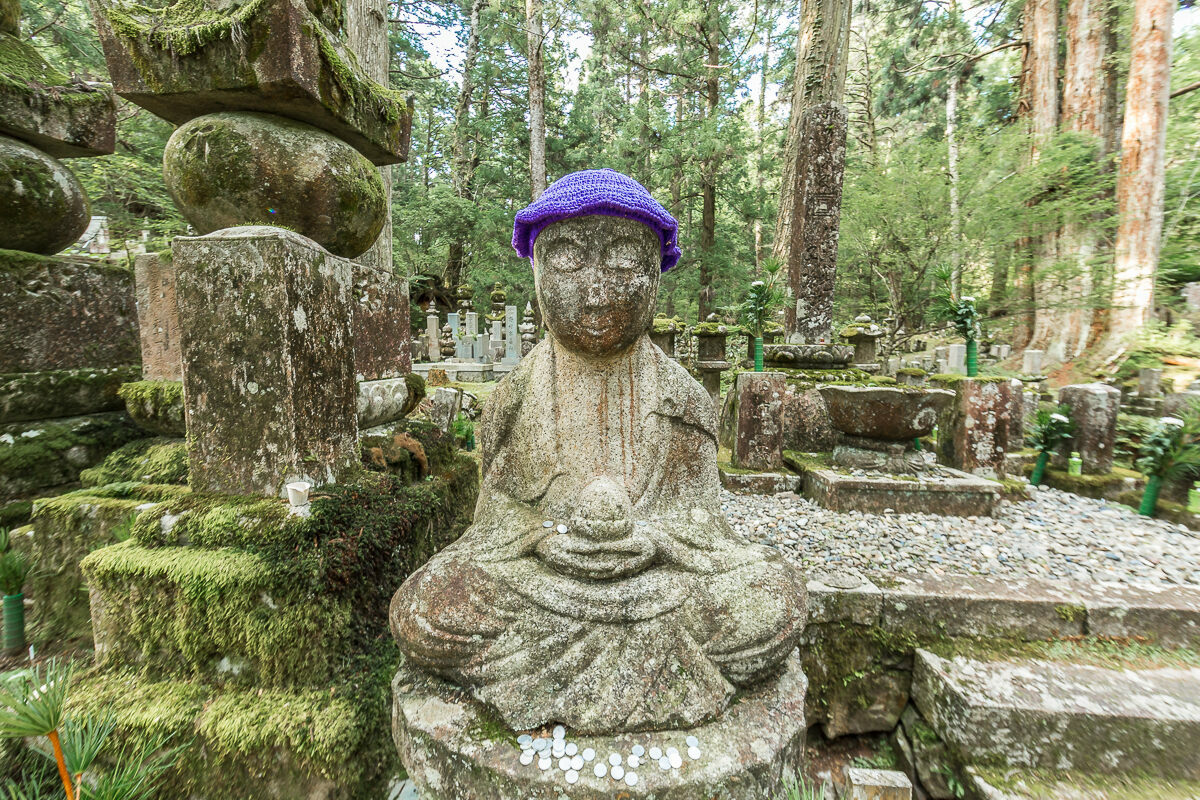 A typical lotus pose for a Jizo, capped in the less-common color of purple.