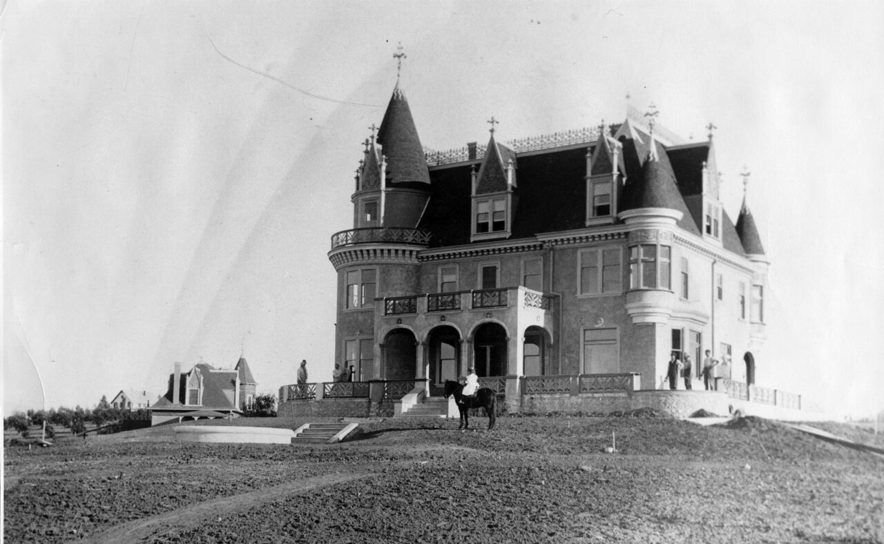 Cornelia Hill in front of her home, c. 1897-1905, before it was sold to J. Alfred Kimberly.