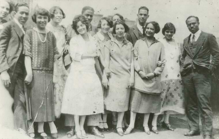 A party on the roof of Regina Anderson's home, at 580 St. Nicholas Ave. in Harlem. From left to right, attendees included Ethel Ray (Nance), Langston Hughes, Helen Lanning, Pearl Fisher, Regina Anderson (Andrews), Rudolf Fisher, Luella Tucker, Clarissa Scott (Delany), Esther Popel, Hubert Delany, Jessie Fauset, Marie Johnson and E. Franklin Frazier.