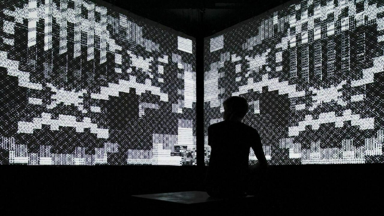 The immersive video cube of <em>Cave Exits</em>, another one of Burr's infinite dungeon-inspired installations.