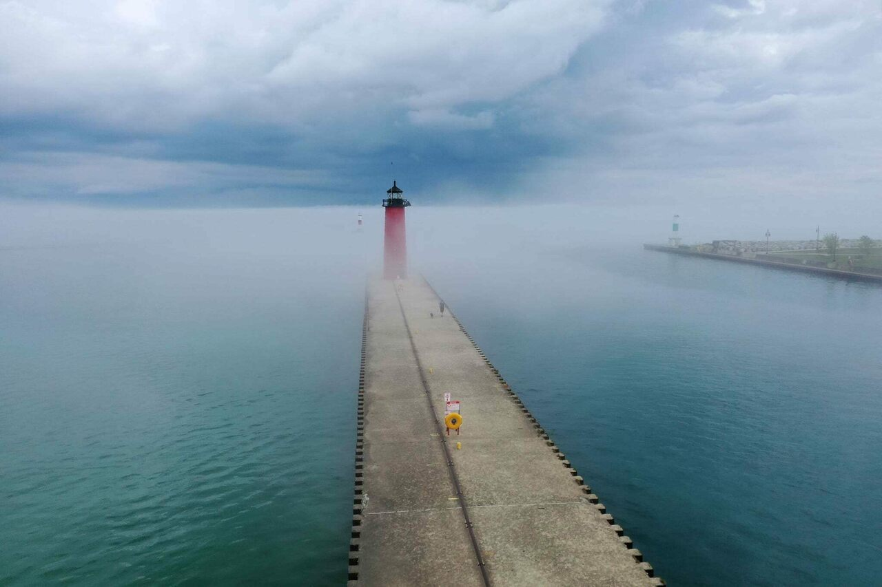 On May 23, 2021, atmospheric fog and clouds accompanied a pneumonia front in Kenosha, Wisconsin.