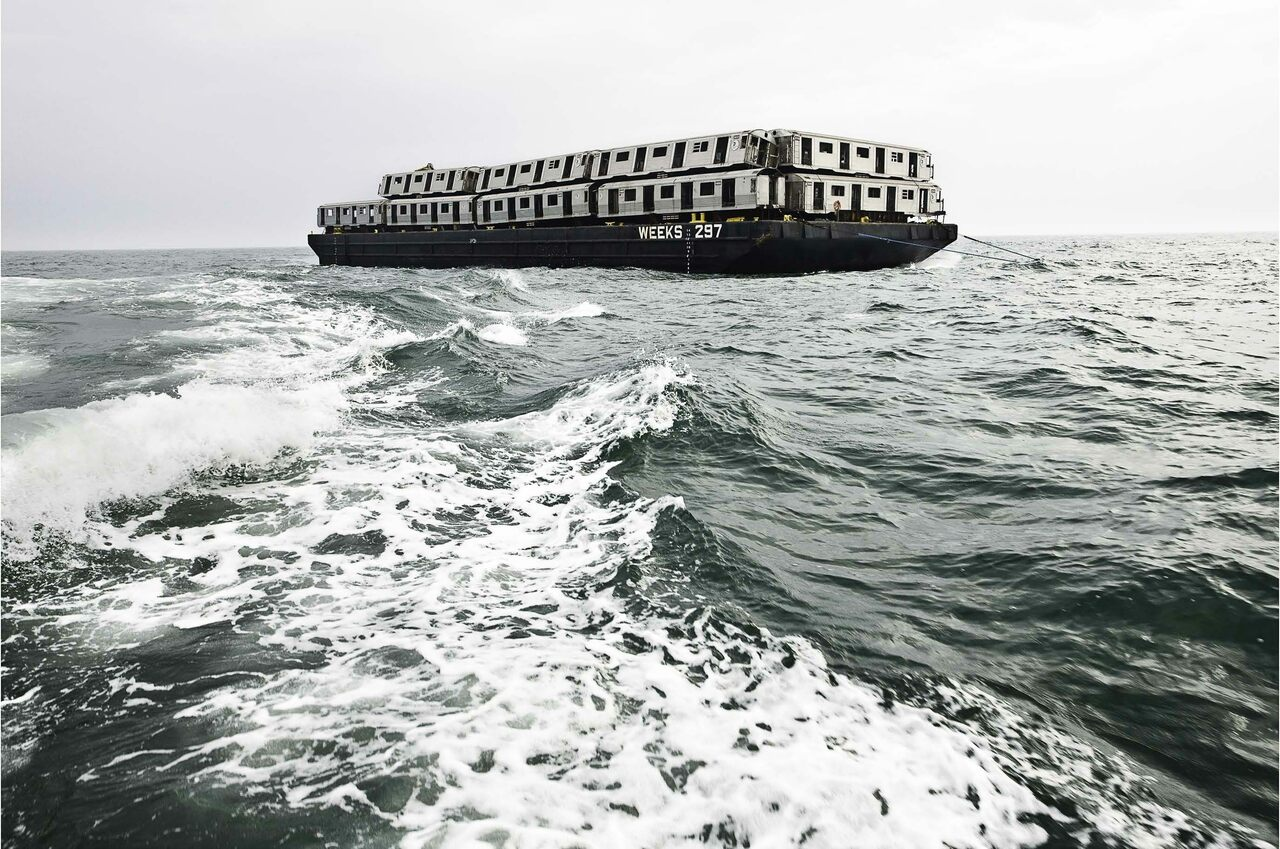 "Subway cars set sail on a barge in ""Weeks 297, 2008."""