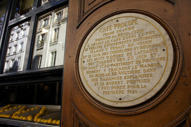 The plaque outside Le Procope in Paris.