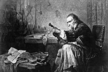 A 1920s imagining of the 18th-century luthier Antonio Stradivari examining an instrument.