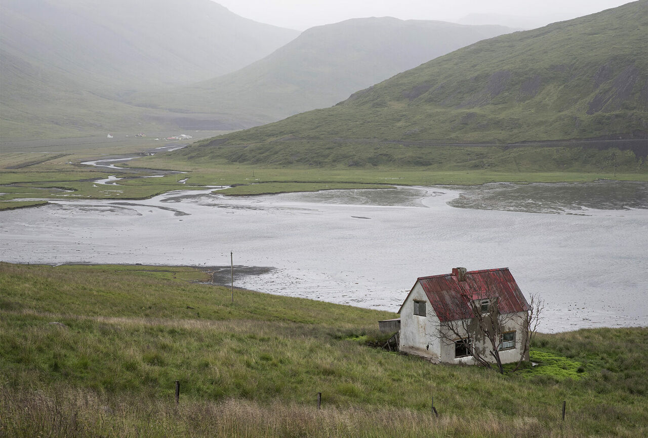 An abandoned cottage by an inlet in Iceland's Westfjords.