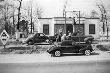 "Joe Littlejohn's racecar (No. 7) is seen outside ""Little Joe's"" tavern in the late-1930s."