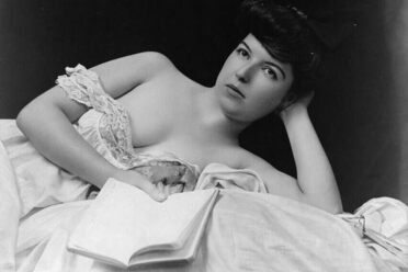 A photograph by F. W. Guerin from the turn of the century shows a woman holding  a book.