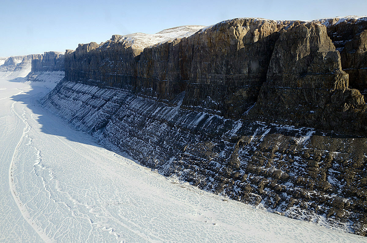 Northern Greenland is covered in rock and ice. The longest and deepest canyon on the landmass is buried miles below.
