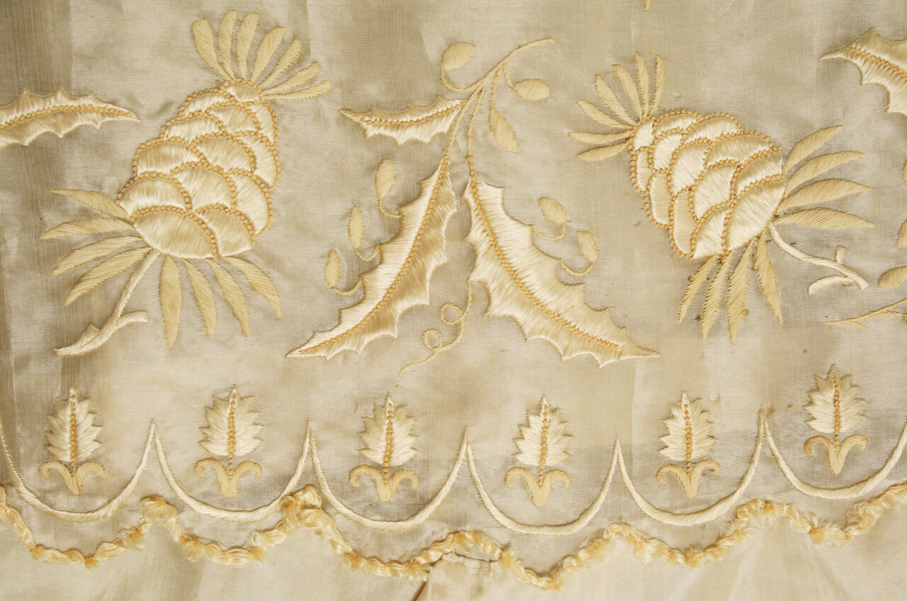 A detail from a Regency-era dress made of silk and piña.