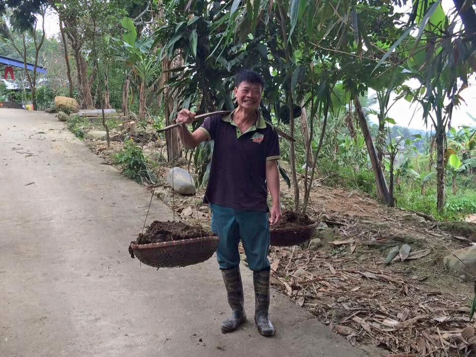 A springy bamboo pole helps a villager lighten his load.